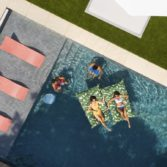 Group of friends enjoying a variety of Top Spot's in pool furniture.