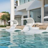 Ledge Lounger in pool furniture with Signature Headrest Pillows adding extra comfort and style.