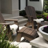 Ledge Lounger Legacy Adirondack chairs on a porch.