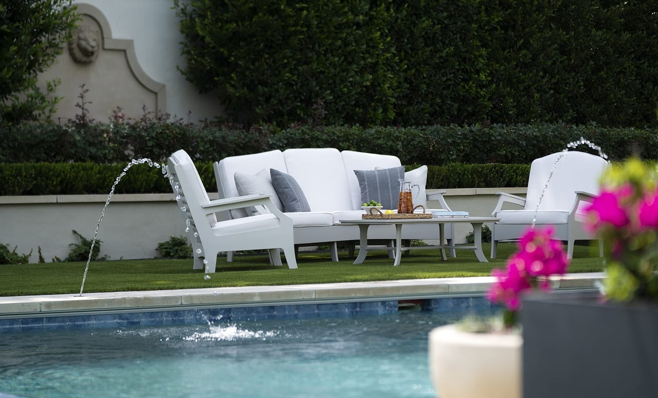 Affinity Sofa and chairs poolside.
