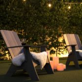 Two Ledge Lounger Adirondack chairs in the evening.