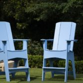 Add a pop of color with an Adirondack chair in your favorite color choice.