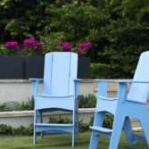 Ledge Lounger Adirondack chairs in a soothing blue color.