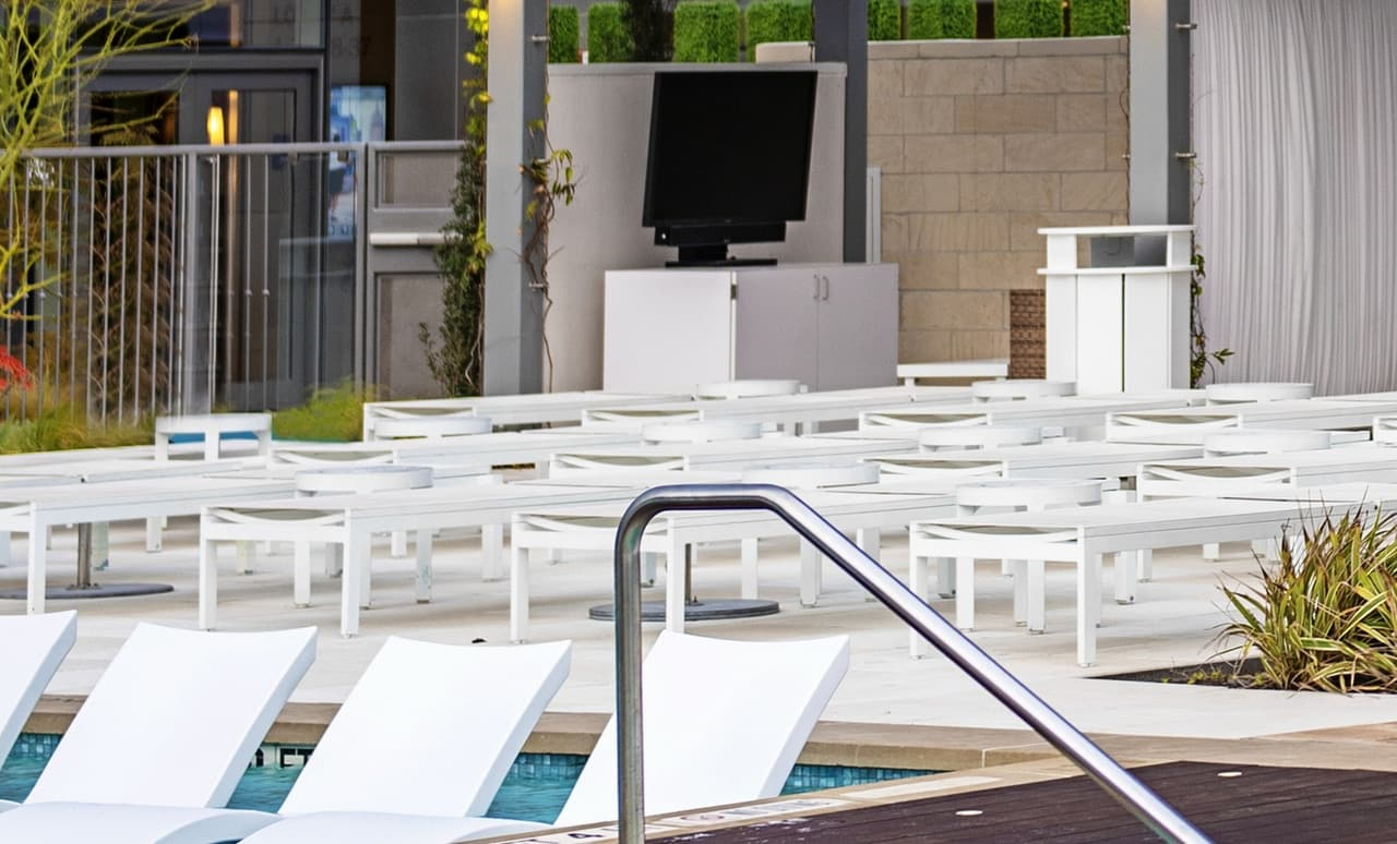 Ledge Lounger in pool furniture in a commercial pool.