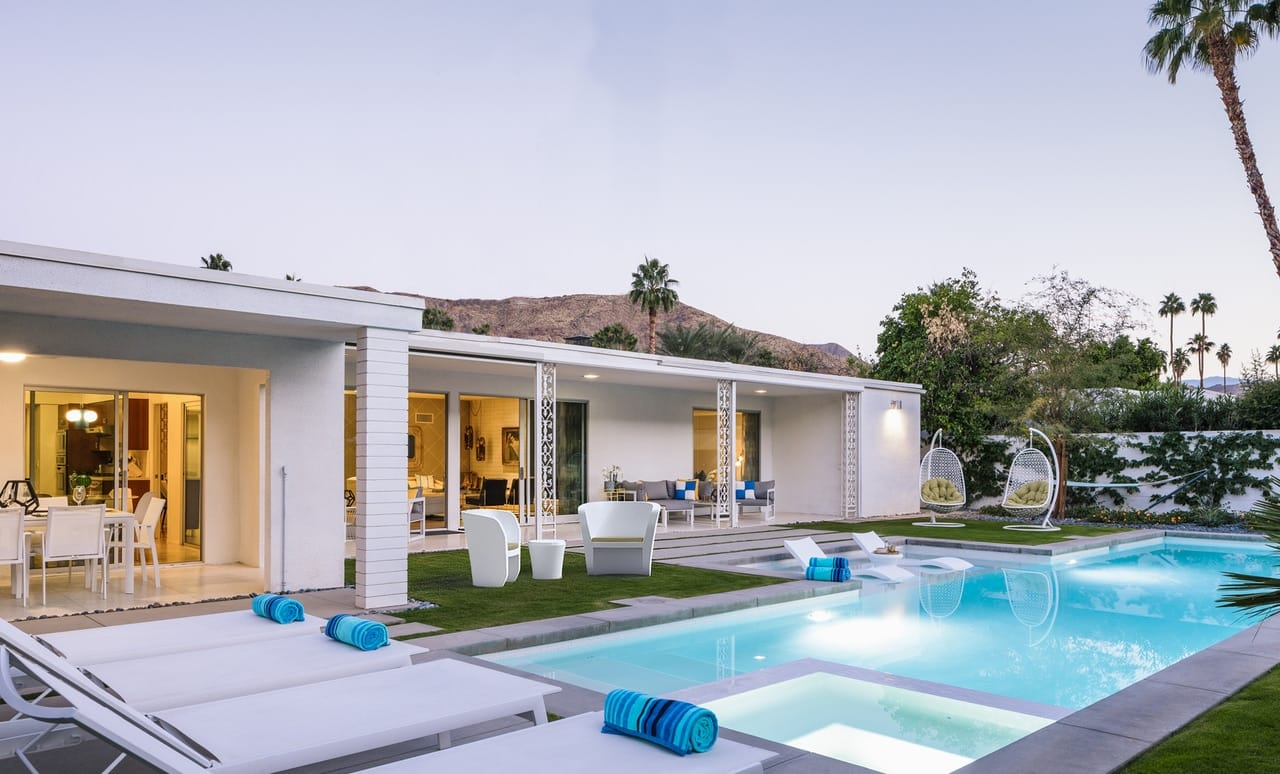 Backyard poolscape featuring a variety of Ledge Lounger in pool and outdoor furniture.