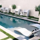 Backyard pool perfectly lined with Affinity Chairs.