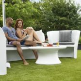 Couple enjoying time together outdoors in the Affinity Loveseat.