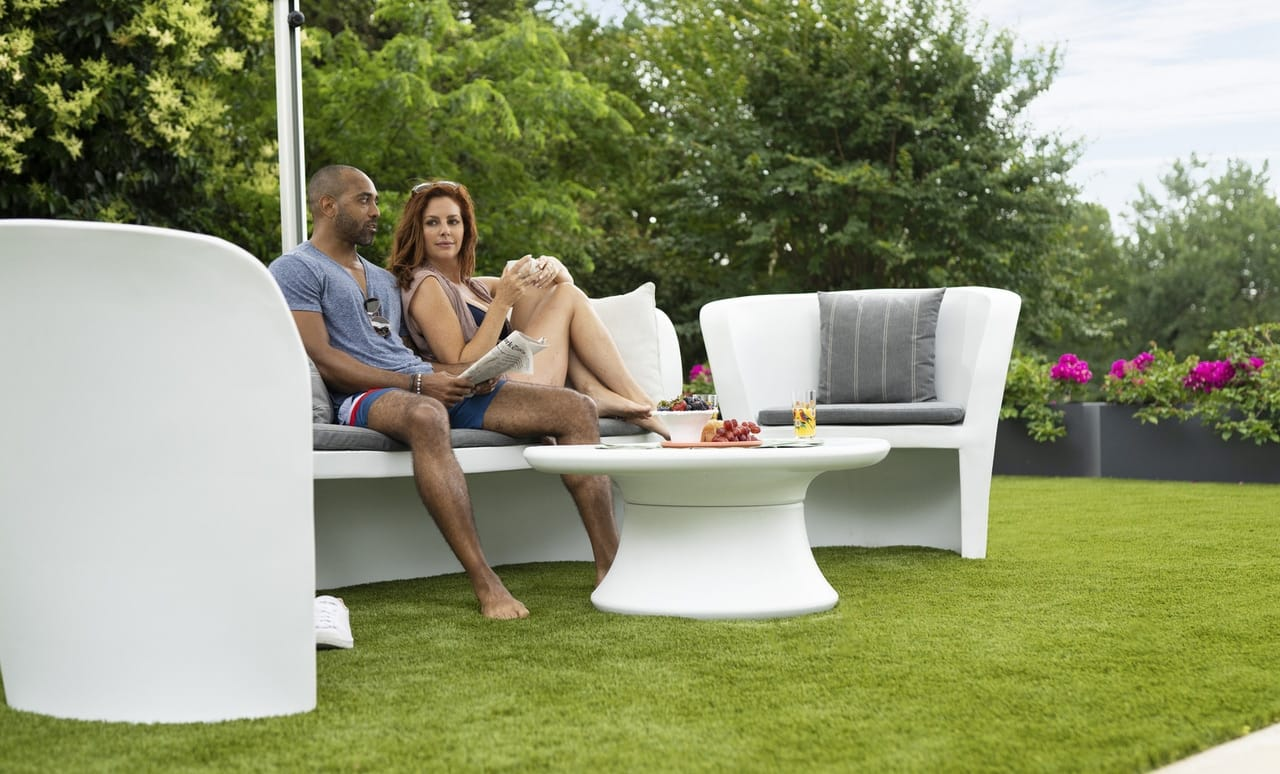 Coupling enjoying the Affinity Loveseat in their backyard.