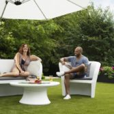 Affinity Loveseat and chair being enjoyed by a couple.