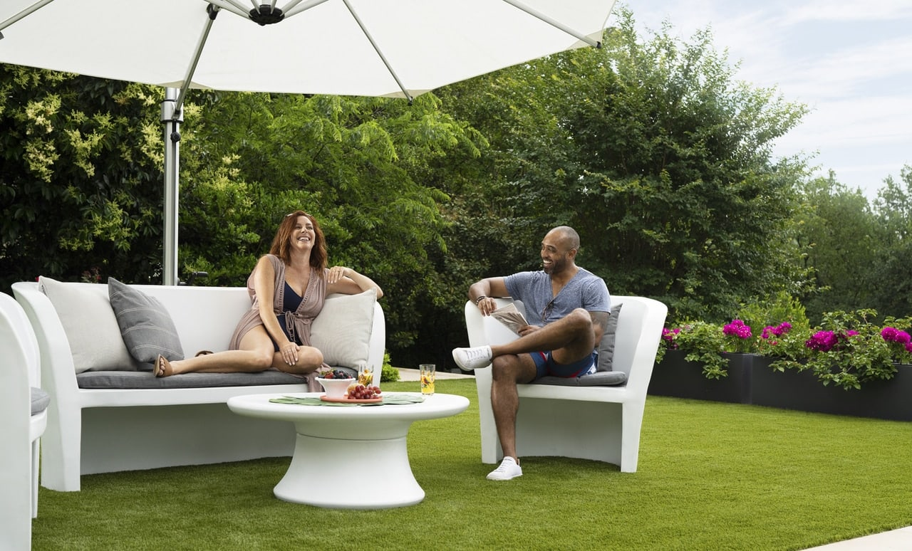 Couple enjoying time together on the Affinity Loveseat and Chair.