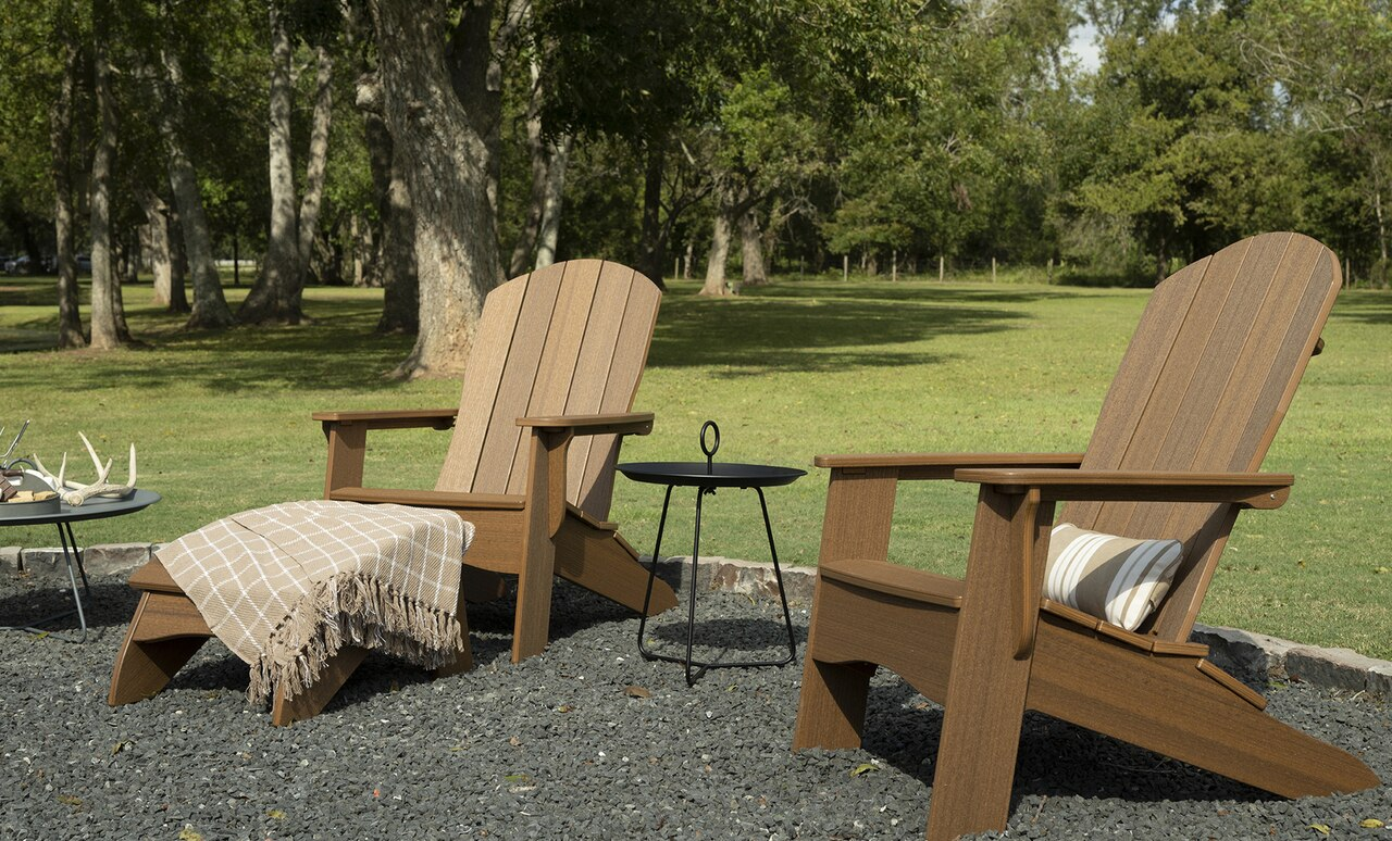 The Playnk round side table nicely accents Adirondack chairs.