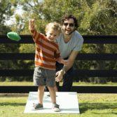 Family enjoys Ledge Lounger cornhole outdoor game.