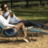 Couple enjoys a pair of Playnk chairs.
