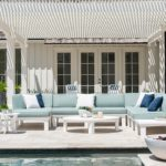 Backyard scene with Ledge Lounger sectional and a variety of tables.