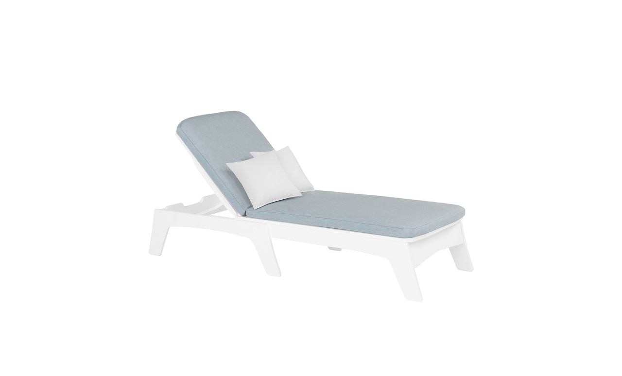 The Ledge Lounger Mainstay Chaise with blue cushion and pillows.