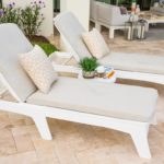 Patio area featuring a variety of Ledge Lounger outdoor patio furniture.