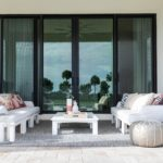 Beautiful outdoor entertainment area with Ledge Lounger patio furniture.