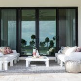 Ledge Lounger outdoor patio furniture on a porch.