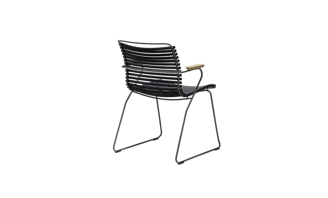 The Ledge Lounger Playnk Dining Arm Chair in black.