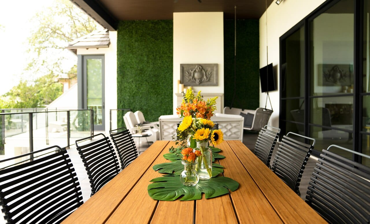 Beautiful outdoor dining table with Playnk Dining Armchair's in sleek black.
