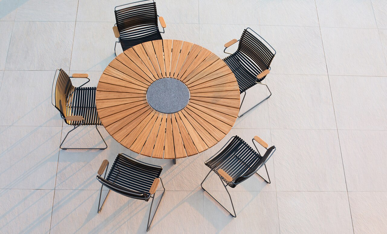 The Playnk Round Dining Table infuses style into any outdoor space.