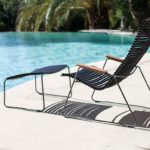 The Playnk chair and ottoman offer a comfortable place to put your feet up by the pool.