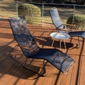 A set of Playnk Chaise loungers on an outdoor deck area.