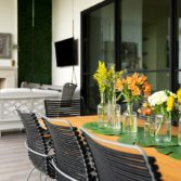 Beautiful outdoor dining area featuring the Playnk dining chairs and table.
