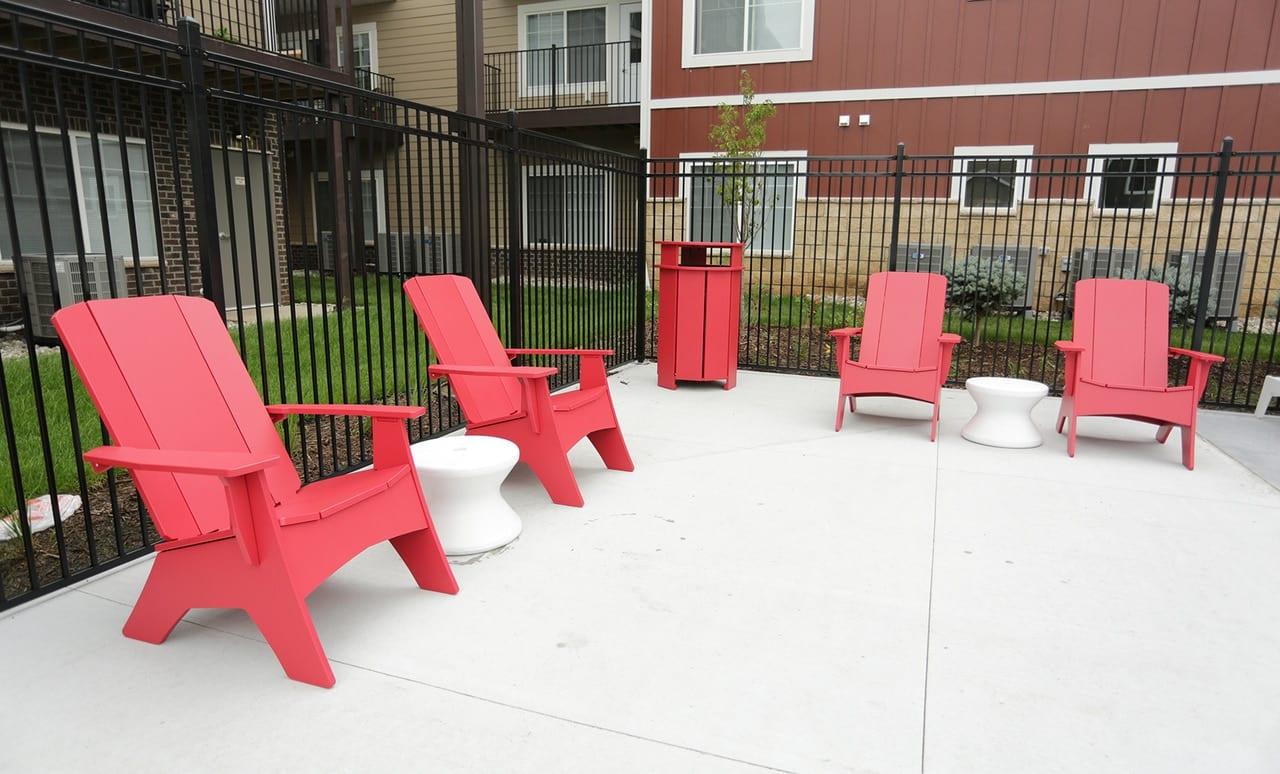 The Mainstay Trash Bin perfectly matches the set of Adirondack chairs.
