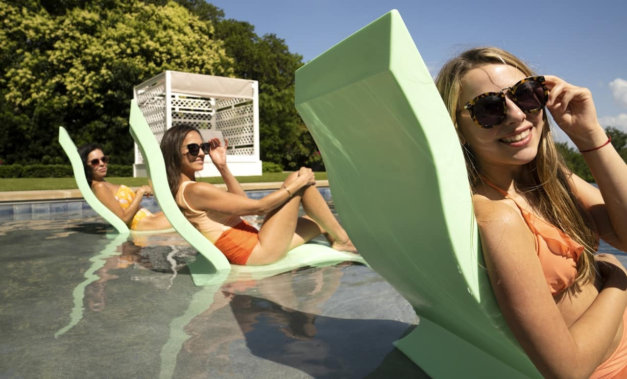 Friends enjoying their Ledge Lounger Signature Chairs.