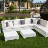The Ledge Lounger Signature Sectional creates an inviting outdoor sitting area.