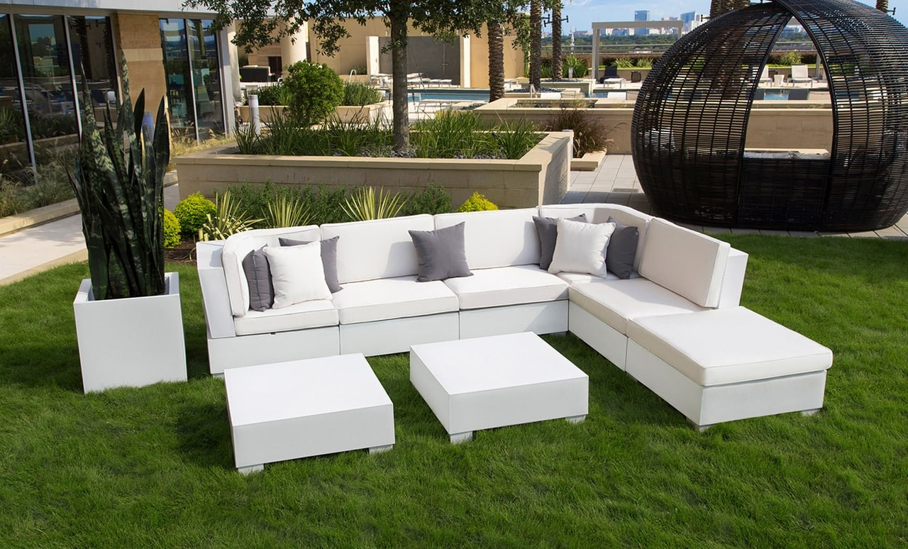 Add seating and sophistication to your outdoor space with the Signature Sectional & ottoman.