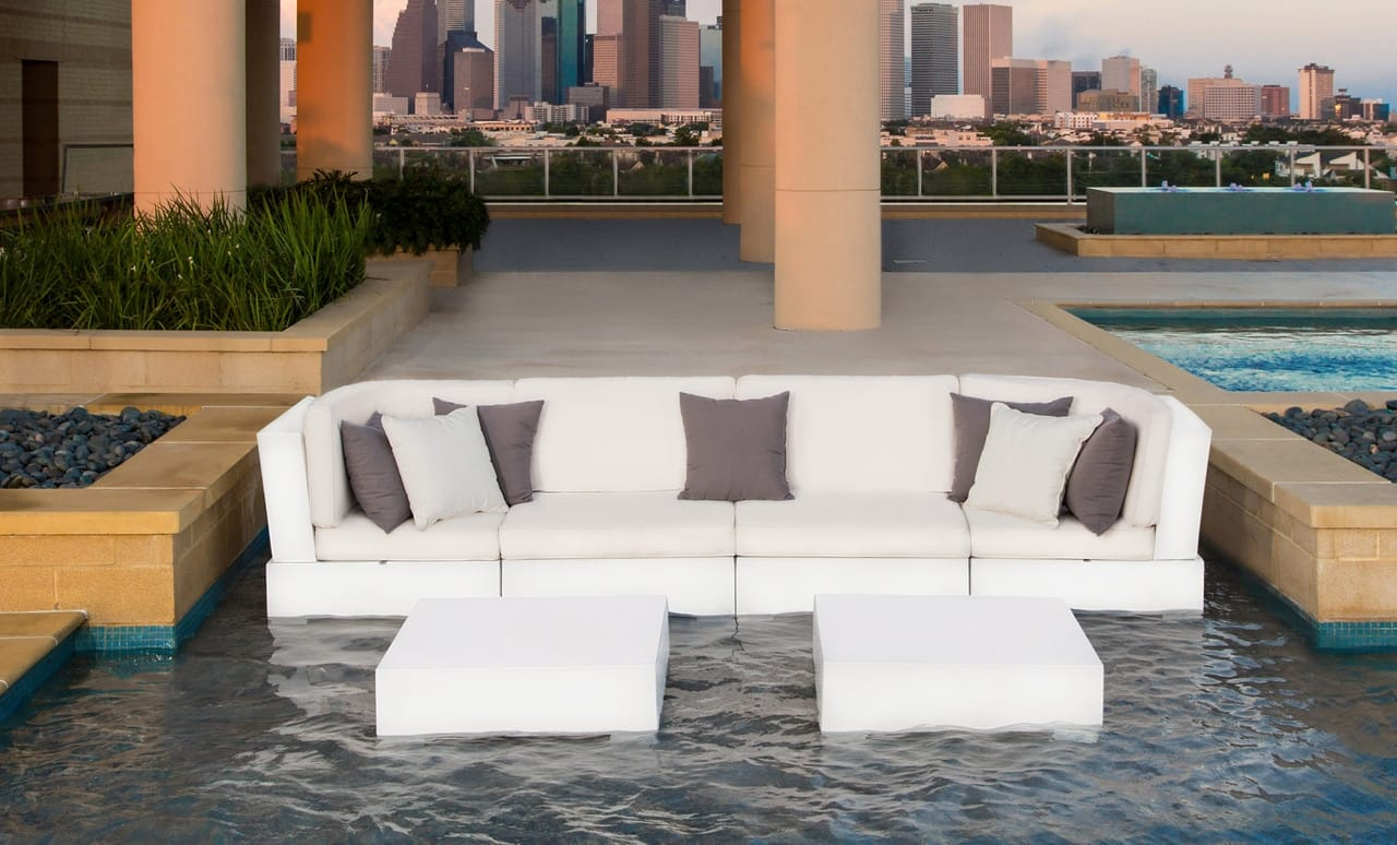Sit back and relax with this in pool sectional with matching ottomans.