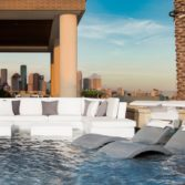 Ledge Loungers in pool sectional and Signature Chaise on a pool ledge,.