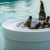 The Signature Ice Bin Side Table by Ledge Lounger keeps drinks cool in and around the pool.