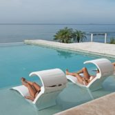 The Ledge Lounger Signature Chaise Shade offers protection from the sun while you lounge.