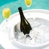 The Signature Ice Bing Side Table keeps refreshments cool in and around the pool.
