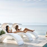 Ledge Loungers with Signature Shades allow for lounging and shade poolside.