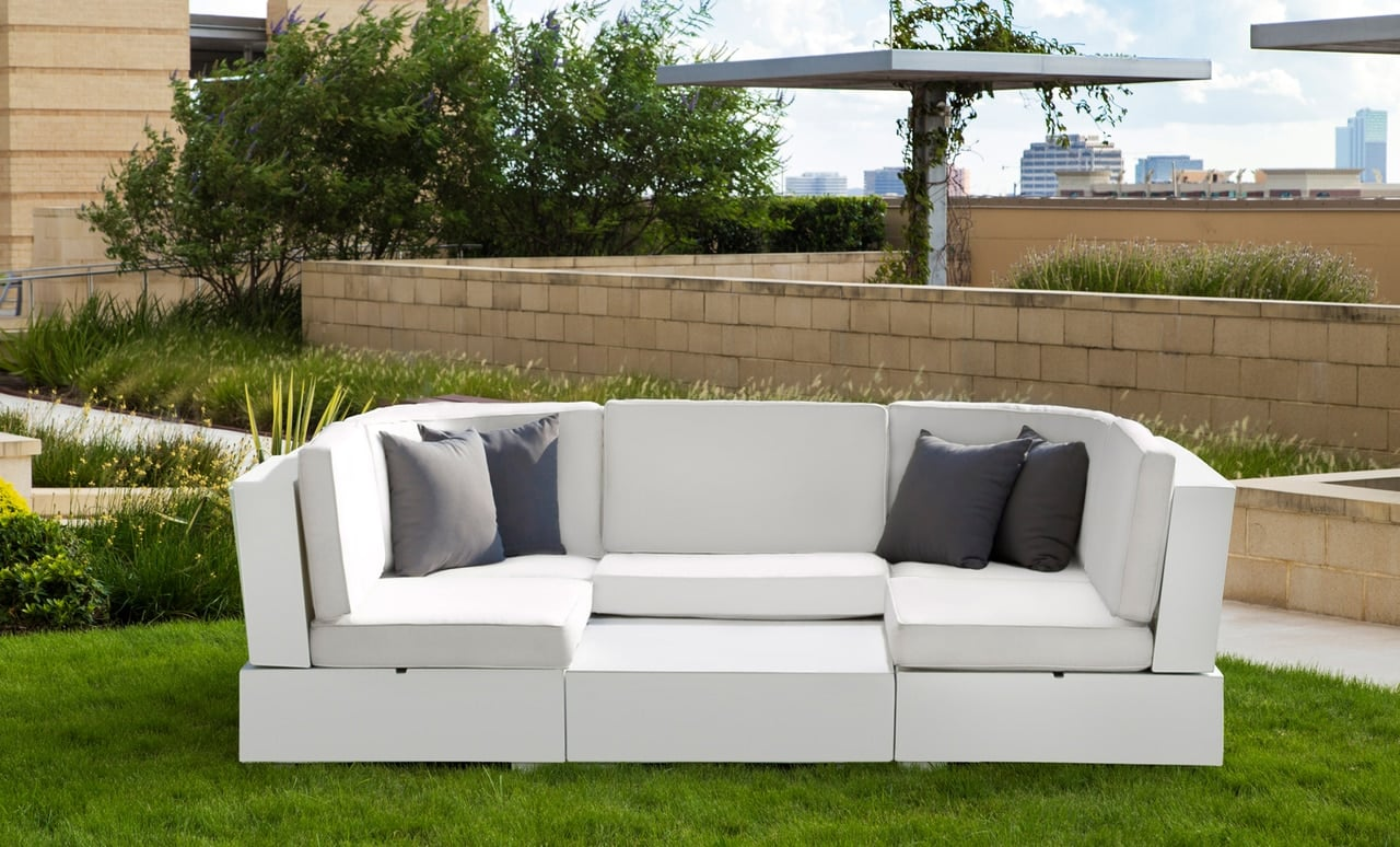 Signature Sectional in a backyard with throw pillows.