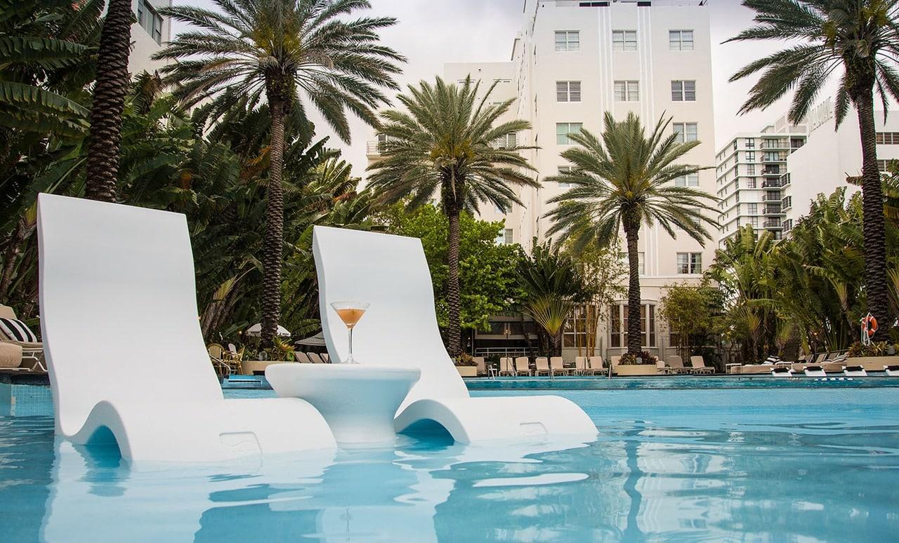 Ledge Lounger Signature Chaise on the pool ledge.