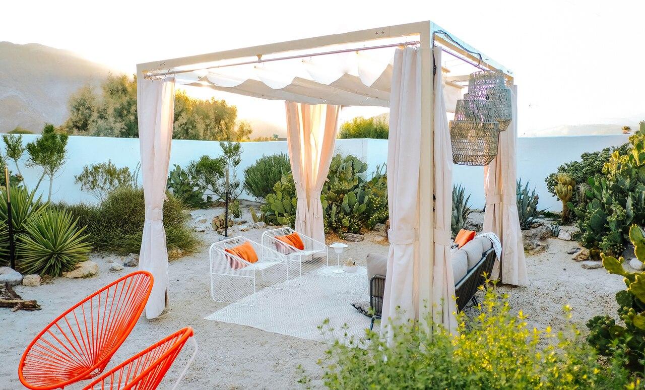 A Modern Cabana dresses up a beach.