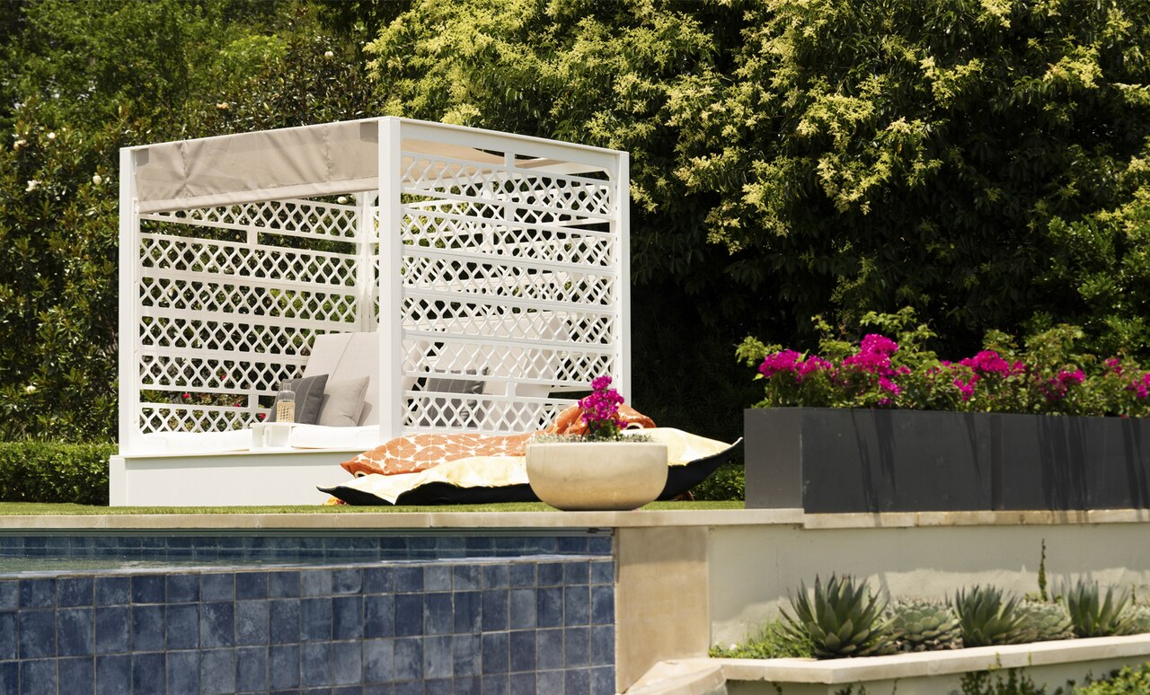 Shift Daybed and Laze Pillows near a pool ledge.