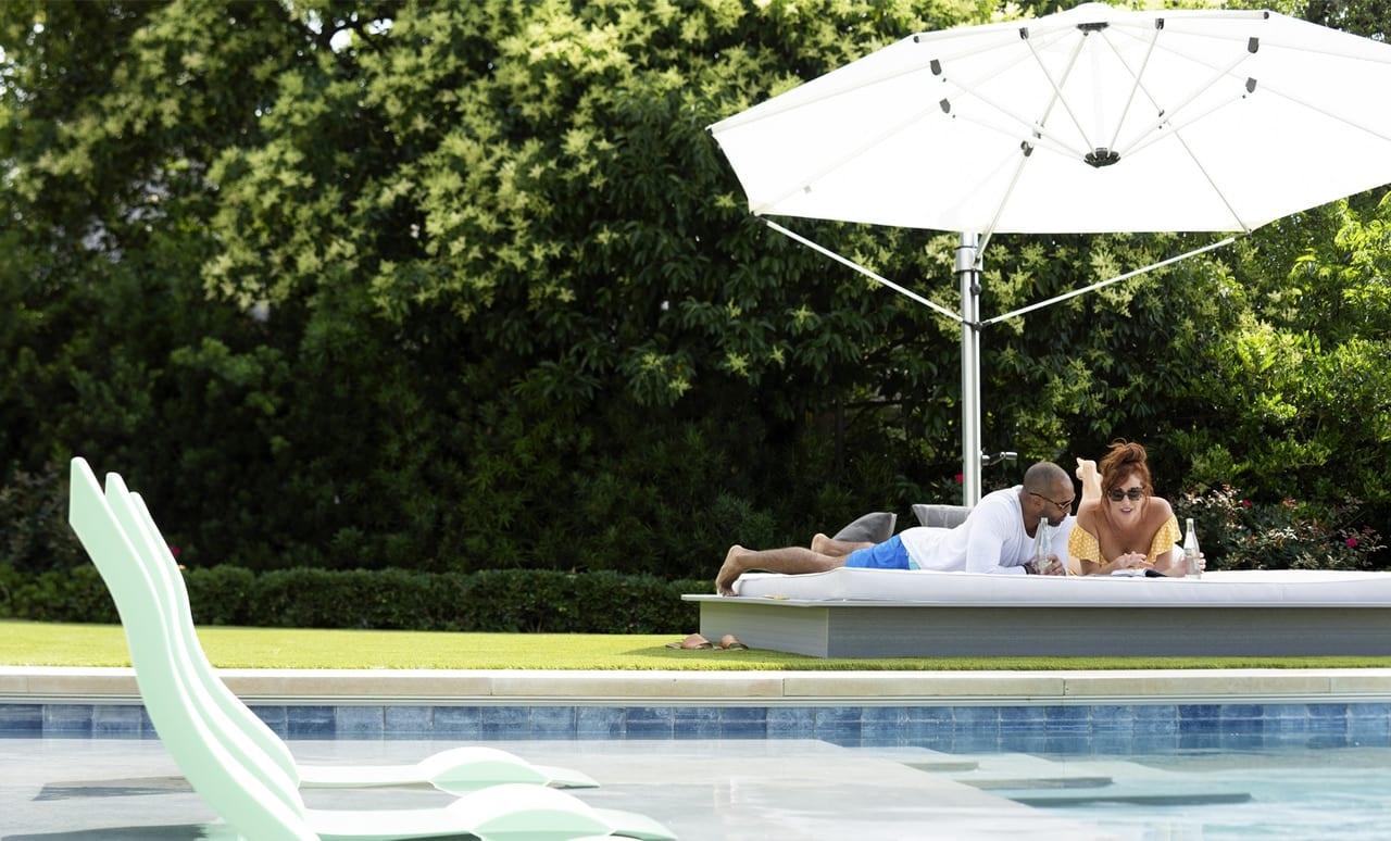 Couple enjoying the shade of a Ultra Umbrella.