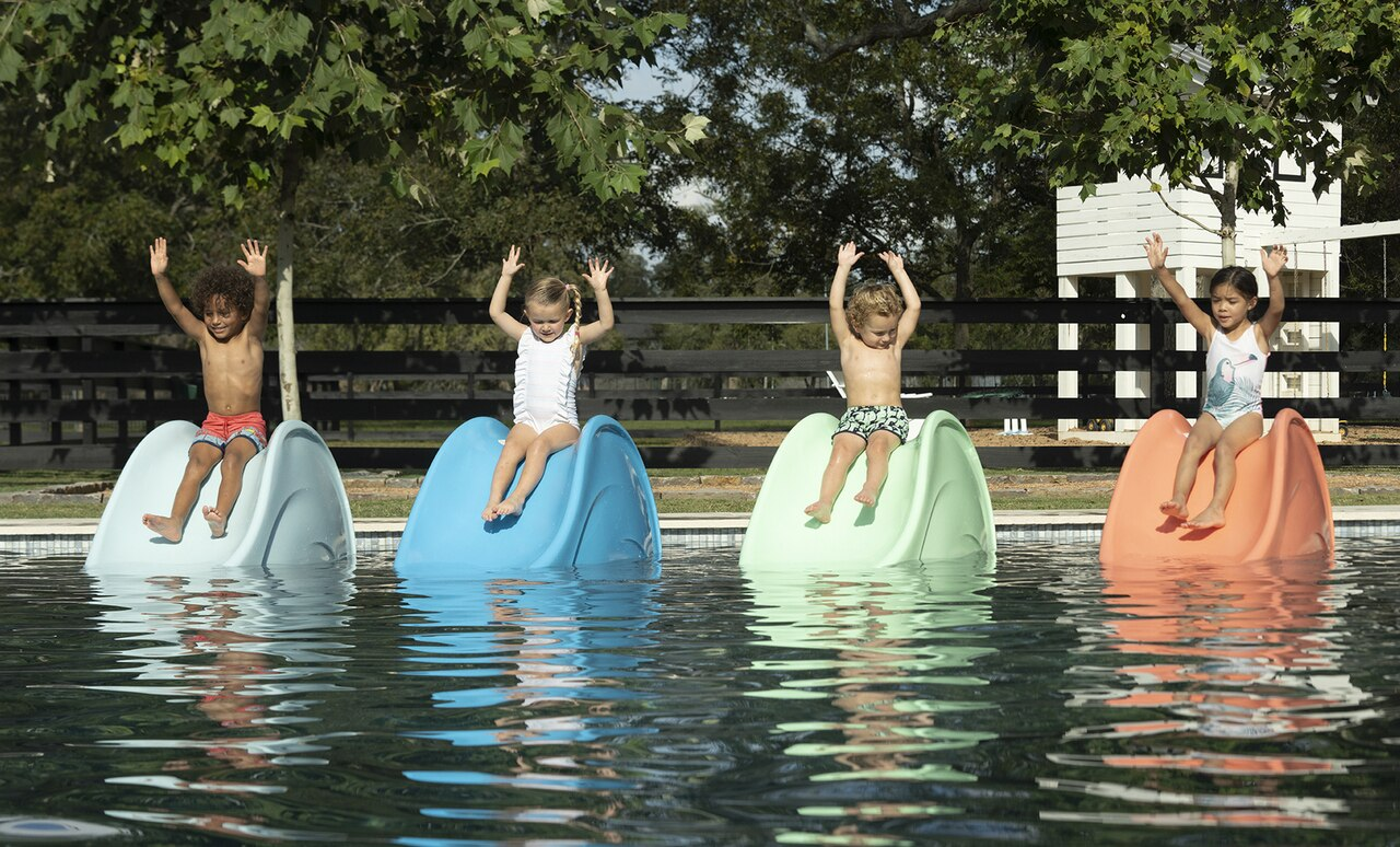 Signature Slides by Ledge Lounger being enjoyed by children.