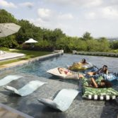 Signature Chaise and Laze Pillows in a beautiful pool.