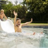 Children playing on the sleek Signature Slide by Ledge Lounger.