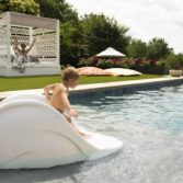 The Signature Slide will add hours of fun to any pool.