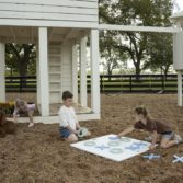 Children play outdoors with Ledge Loungers games.