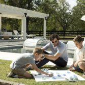Family plays a game poolside.