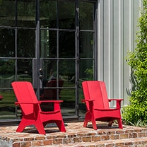 Red Adirondak chairs by Ledge Loungers